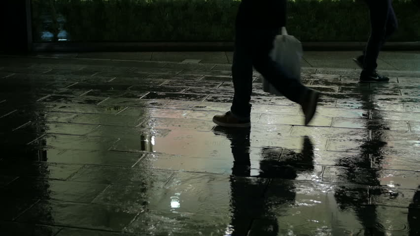 Slow motion silhouette of pedestrians walking on rainy pavement reflecting city illumination. Ginza, Tokyo. | Shutterstock HD Video #9566327