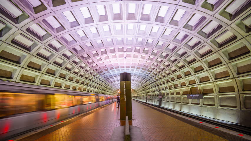WASHINGTON, D.C. - APRIL 10, 2015: Trains and passengers in the Foggy Bottom-GWU Metro Station. Opened in 1976, the Washington Metro is now the second-busiest rapid transit system in the U.S.