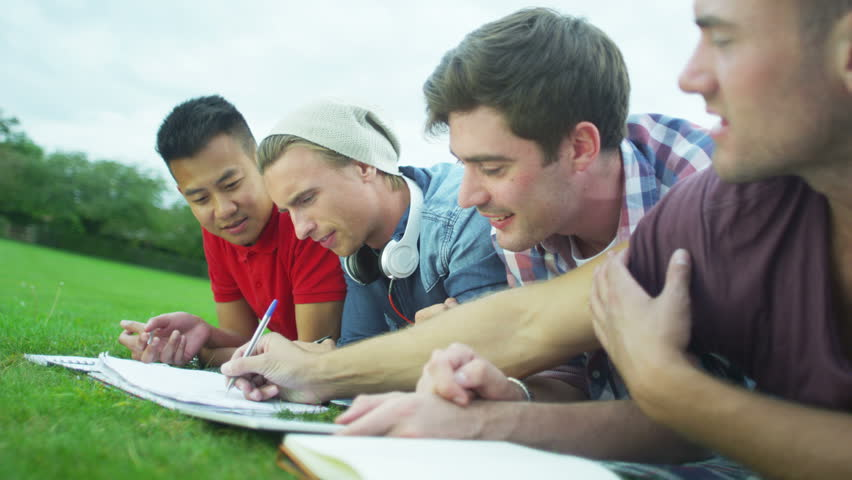 4K Cheerful male student group working together outdoors #9584534