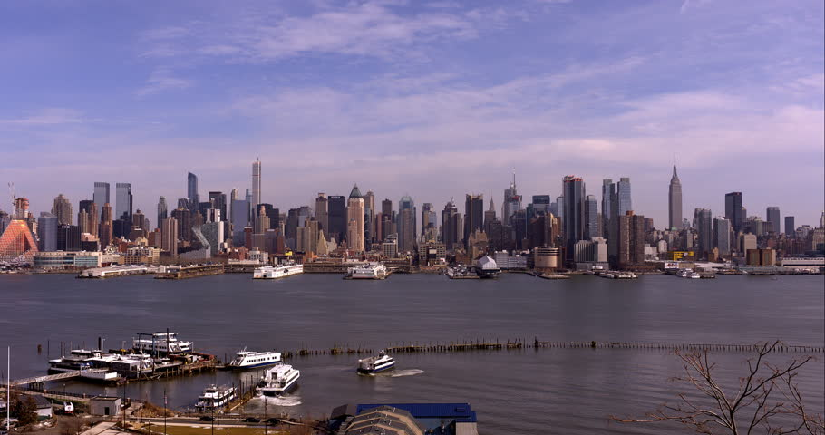 Time-lapse of the midtown Manhattan skyline in the morning. Commuter ferries zip along the Hudson River. | Shutterstock HD Video #9598724