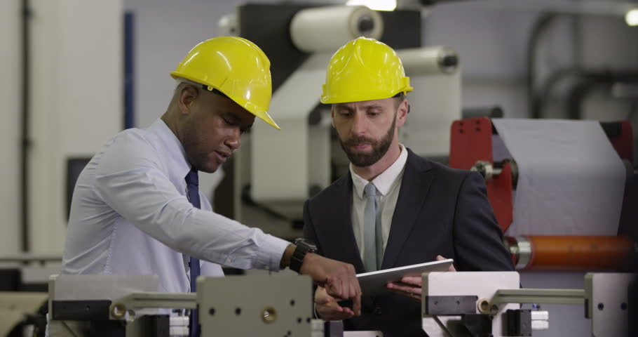 Manager and assistant in a factory. In slow motion