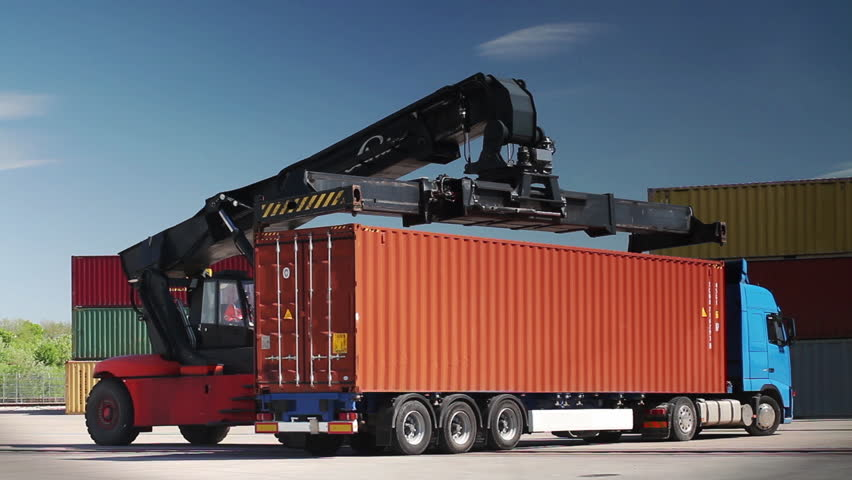 Container Handler loading a Truck in Port Terminal.