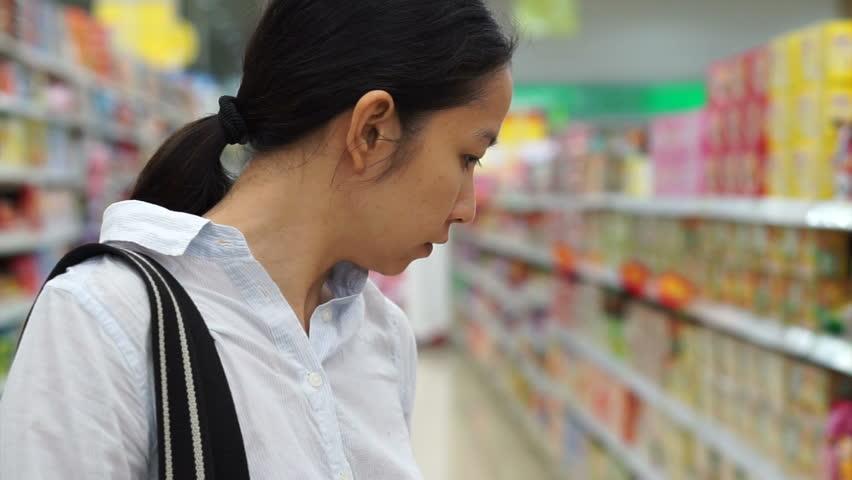 Asian girl, woman shopping snacks in supermarket | Shutterstock HD Video #9623966