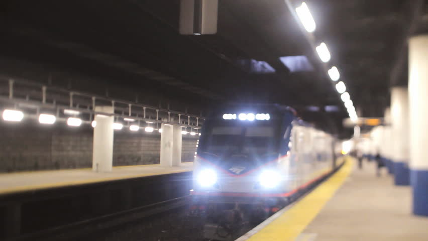 PROVIDENCE, RI - APRIL 17: Amtrak train pulls into station on April 17, 2015. Amtrak operates more than 300 trains each day on 21,300 miles (34,000 km) of track.