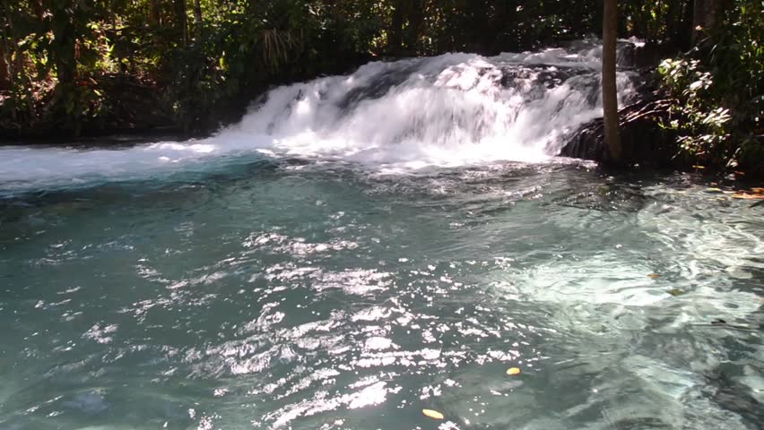 Tourist in Ant waterfall in Rio Ant - Jalapão State Park - Tocantins - Brazilian conservation unit strictly protected nature