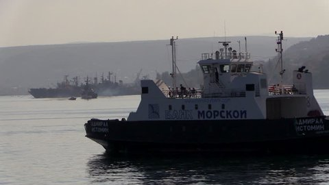 SEVASTOPOL, RUSSIA, 15 SEP 2014: A warm summer day on the Black Sea. The ferry sails on the bay.