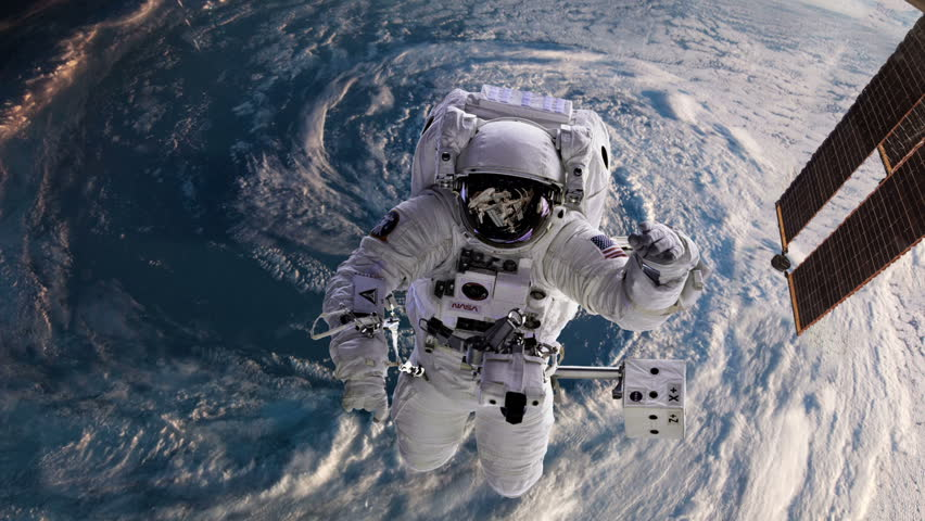 Astronaut in space with Earth, hurricane behind