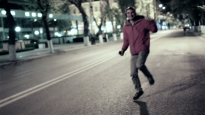Funny guy walk down the night street city, free dancing to music in headphones | Shutterstock HD Video #9640562