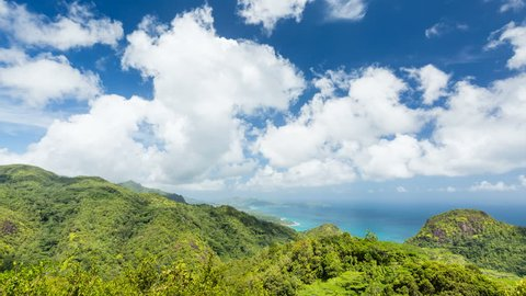 Timelapse sequence from Mission Lodge Lookout in Mahe, Seychelles with view to the south west coast behind rainforest in 4K.