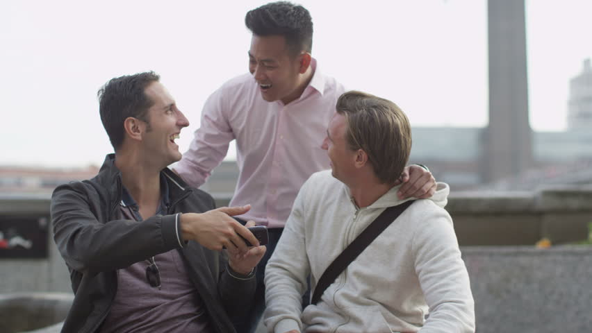 4K Group of casual male friends using mobile phones the city | Shutterstock HD Video #9672323