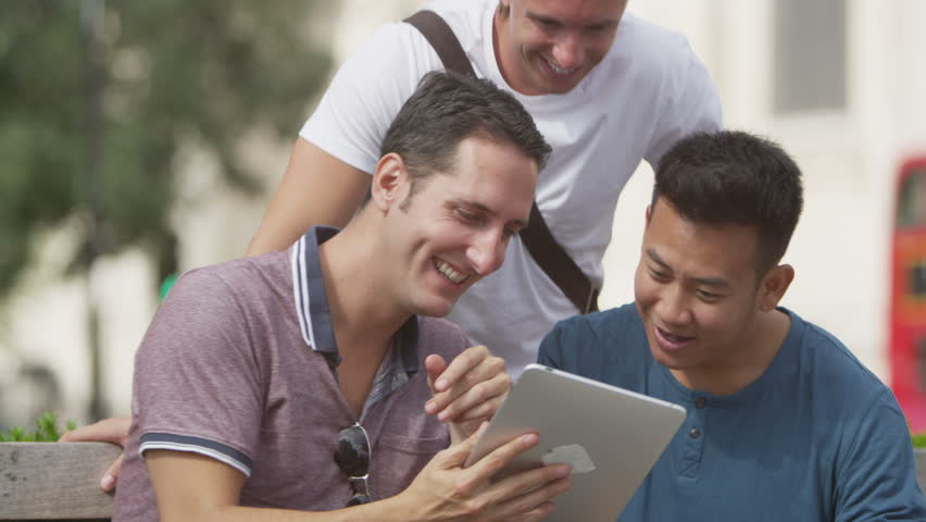 4K Happy casual male friends using computer tablet in the city | Shutterstock HD Video #9672596