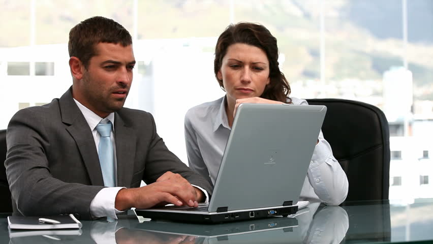 Businesswoman and a businessman working together in a office