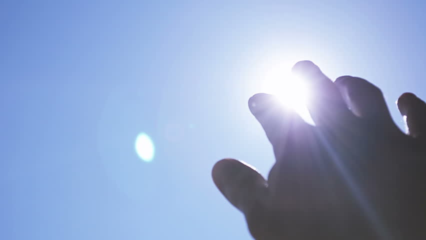 Close-Up Sun Rays Through Fingers Palm  | Shutterstock HD Video #9678080