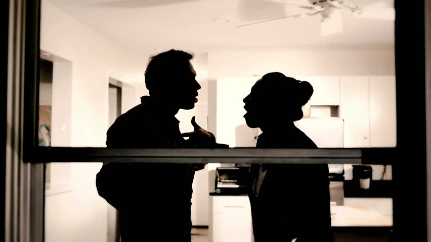 Silhouette of couple man and woman fighting at home, marriage trouble