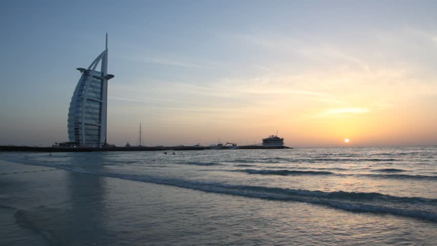 DUBAI - APRIL 17: The Burj Al Arab, five-star hotel, at sunset on April 17, 2010 in Dubai, United Arab Emirates. At 321 m (1,053 ft), the Burj Al Arab is the fourth tallest hotel in the world.