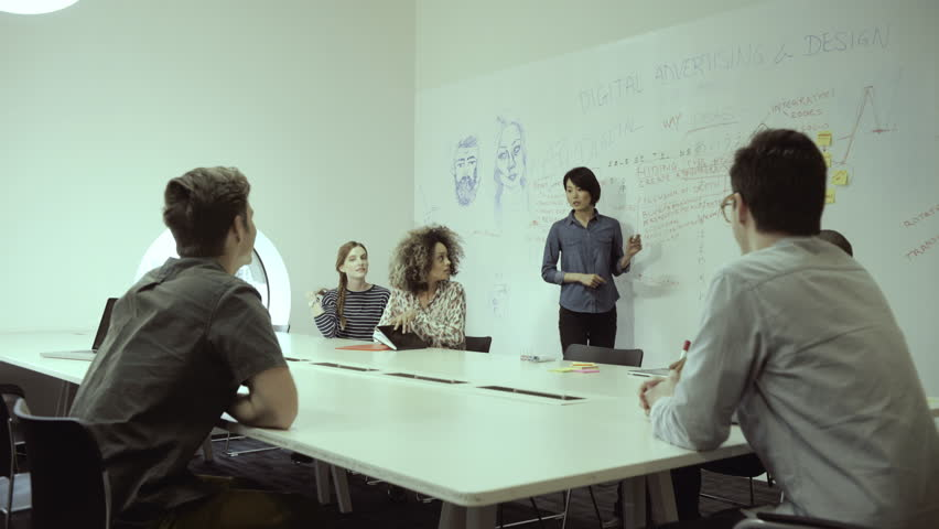 Man and woman entering in conference room and joining the meeting