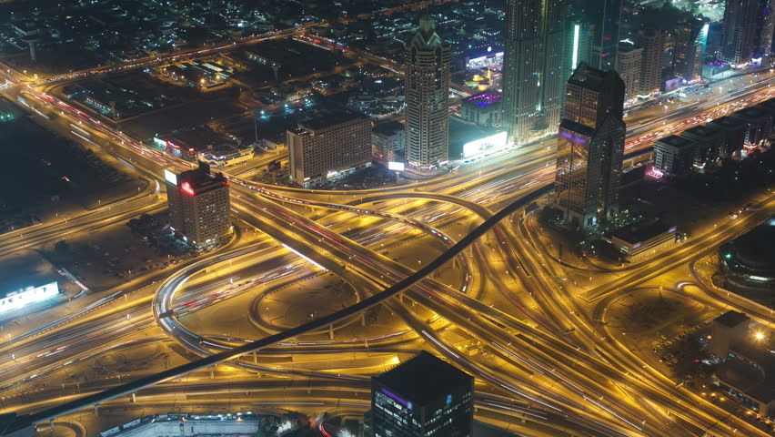 Aerial view of highway junction at night in Dubai, UAE. View from the height of Burj Khalifa timelapse 4K #9698543