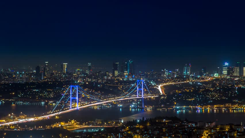 ISTANBUL - APRIL 01: Panoramic Night Time Lapse scene over the Bosphorus bridge and environment from Camlica Hill in Istanbul. 4K Time Lapse. April 01, 2015 in Istanbul, Turkey.  | Shutterstock HD Video #9717653