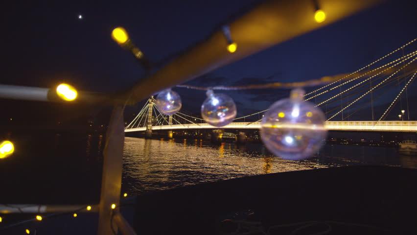 4K Night time view of the Albert Bridge at Chelsea Harbour, London   Shutterstock HD Video #9742892