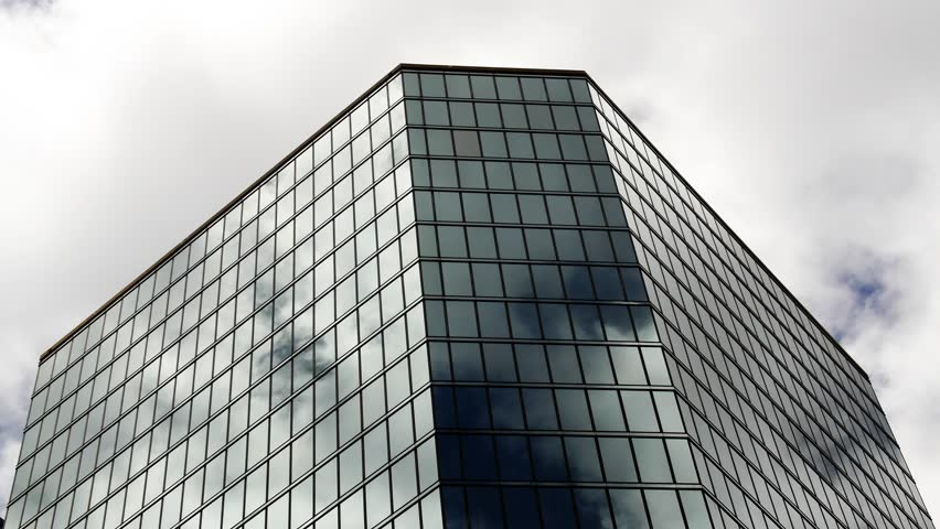 Office building with reflective glass and fast moving clouds | Shutterstock HD Video #9752210