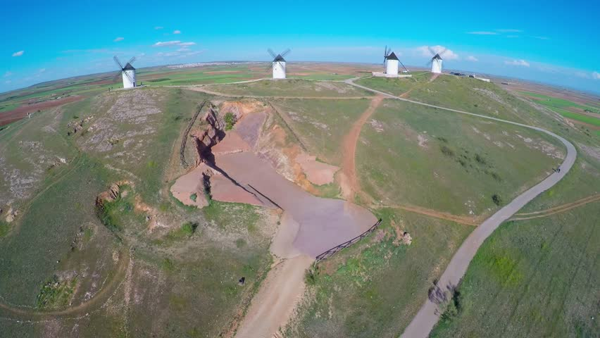Windmills of Cervantes Don Quixote in Consuegra. Castile La Mancha, Spain, Europe - Aerial Wide Angle view from the top - collage