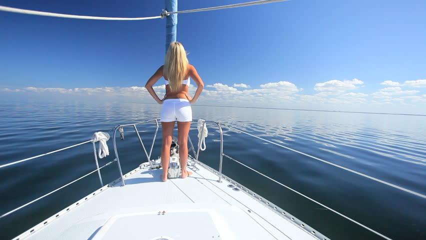 Beautiful blond female in swimwear enjoying leisure time aboard her luxury yacht #976231