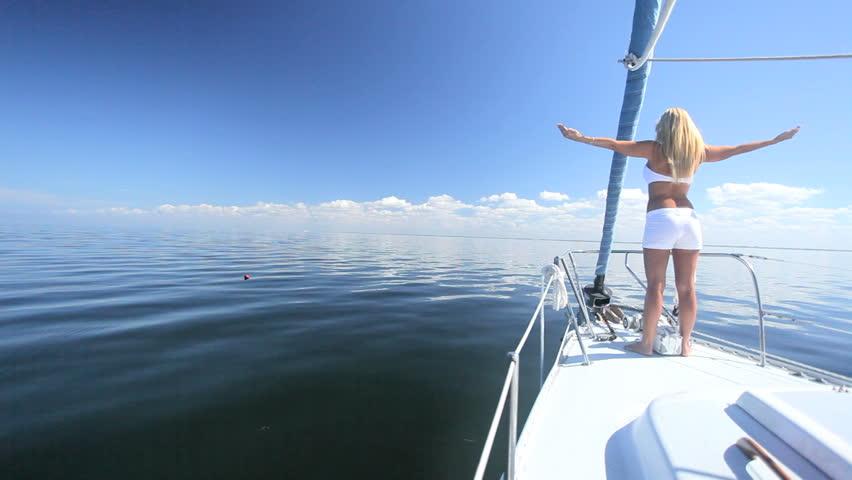 Beautiful blond girl loving the jet set lifestyle aboard a luxury yacht  #976234