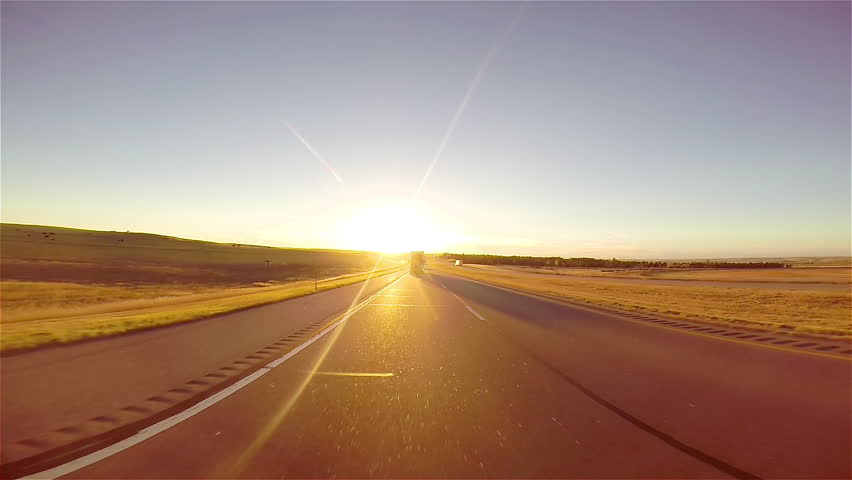Driving down a highway at sunset | Shutterstock HD Video #9764564