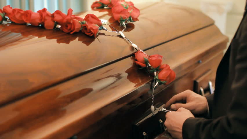 Coffin at funeral service or wake, person giving last respects to deceased  Royalty-Free Stock Footage #9804767