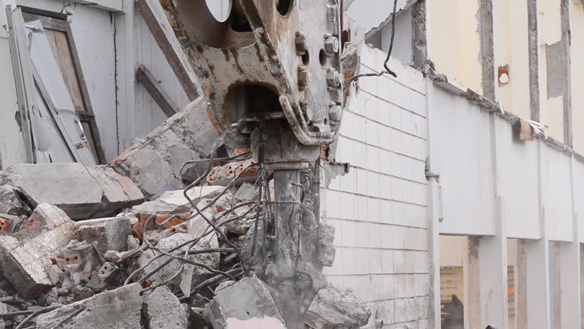 Demolition crane dismantling an old building  | Shutterstock HD Video #9814019