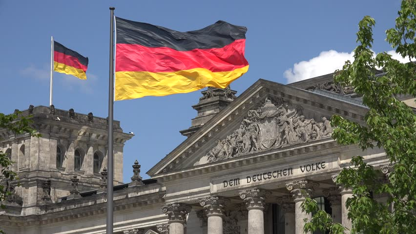 ULTRA HD 4K Closeup of parliament building in Berlin, Reichstag and national flag wave by day