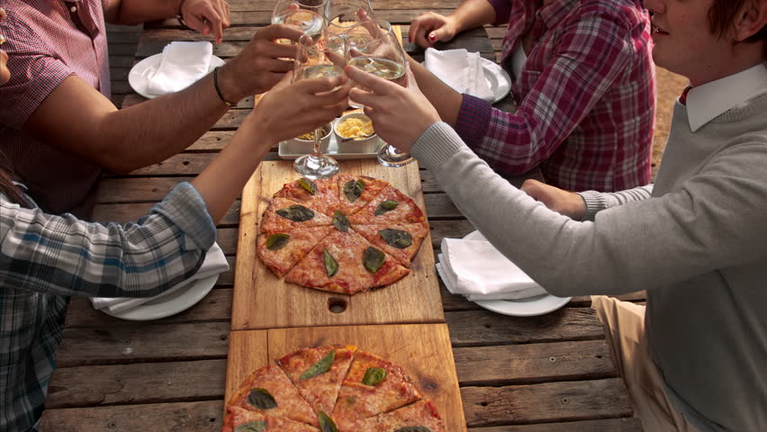 Above shot of  multicultural group of young friends enjoying a meal,  aerial view food pizza meal togetherness concept.
