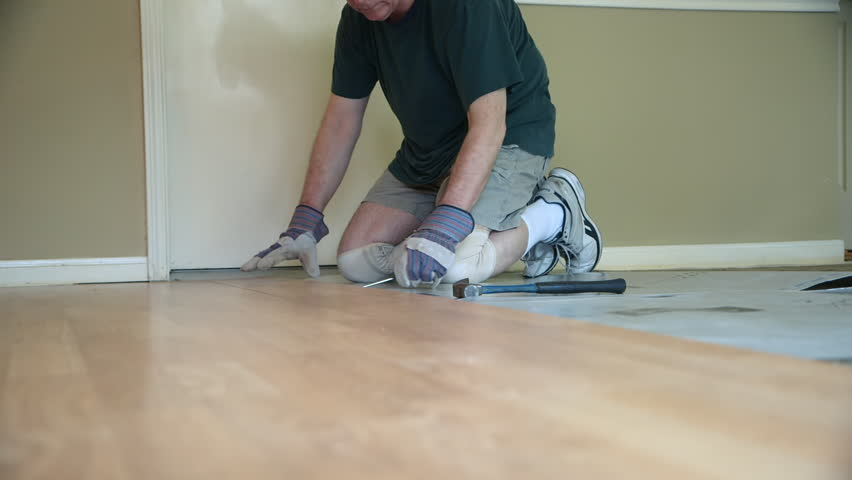 A Worker Removing Old Laminate Stock, How To Prepare Floor For Laminate Flooring