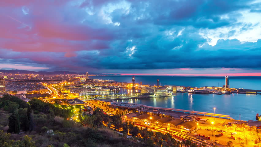 Aerial view timelapse (time lapse, time-lapse) of Barcelona city sunrise from Montjuic mountain mirador, Spain. September 2013.