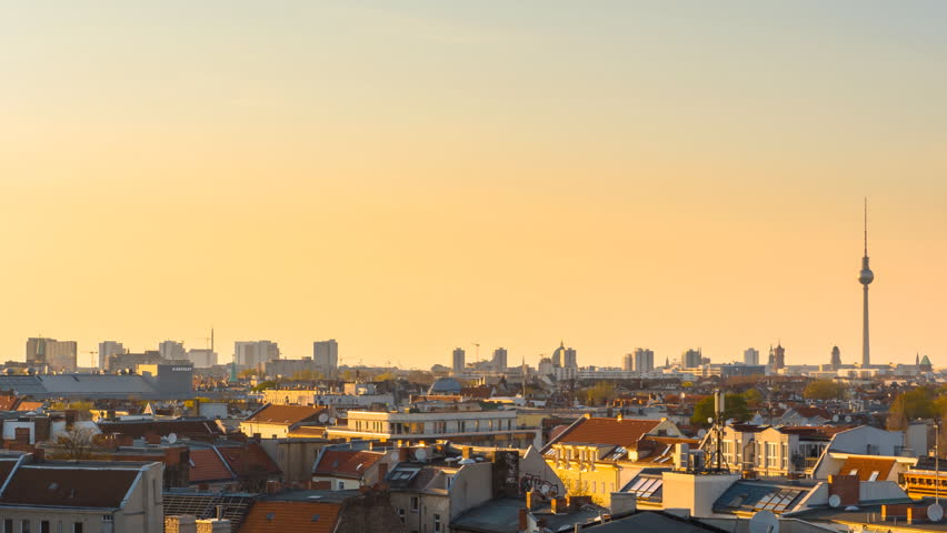 Berlin skyline cityscape timelapse at sunset day to night panning