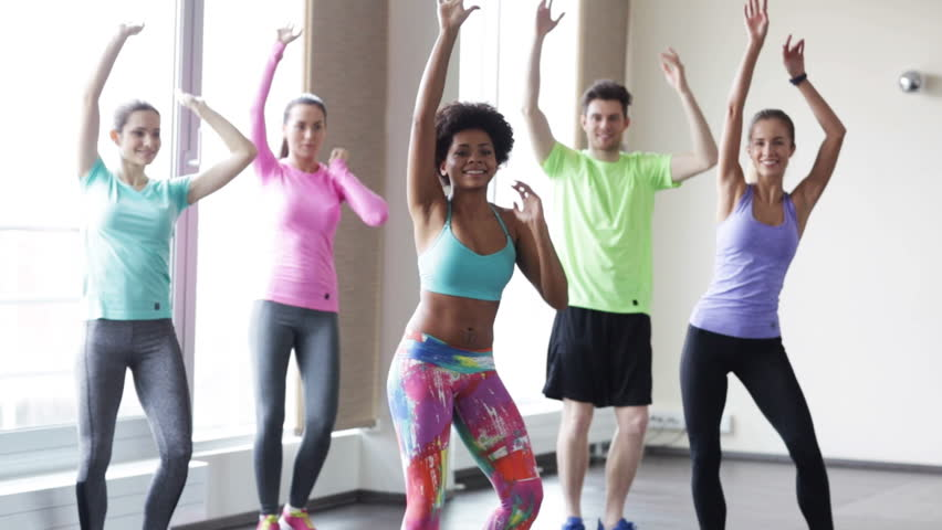 fitness, sport, dance and lifestyle concept - group of smiling people with coach dancing zumba in gym or studio Royalty-Free Stock Footage #9870776