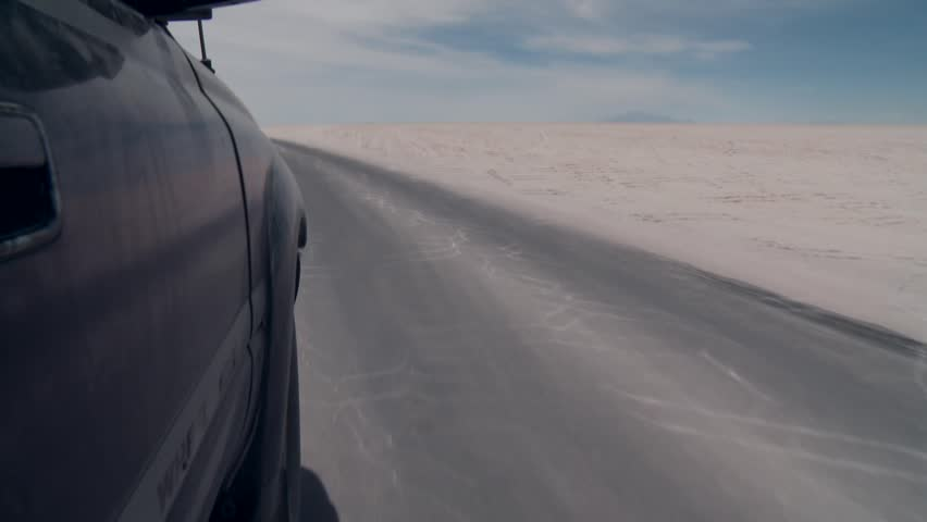 Video footage of a SUV on the salt flat Salar de Uyuni in the Andes of Bolivia #9882896