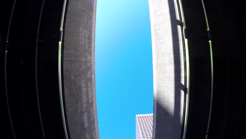 LOS ANGELES, CALIFORNIA, USA - May 2, 2015: Upward view of the architecture and infrastructure of lower Grand and 4th Street in downtown Los Angeles.  | Shutterstock HD Video #9892598