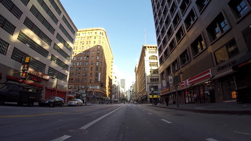 LOS ANGELES, CALIFORNIA, USA - April 26, 2015: Light weekend morning traffic on historic 7th Street in downtown Los Angeles.  | Shutterstock HD Video #9892601
