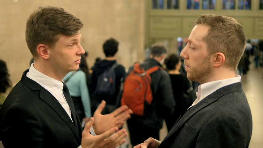 Two young business professionals having a meeting outside. businessman conversation background   | Shutterstock HD Video #9915374