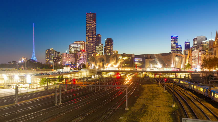 4k motion timelapes video, hyperlapse, of trains arriving and departing from a railyway station in Melbourne, Australia