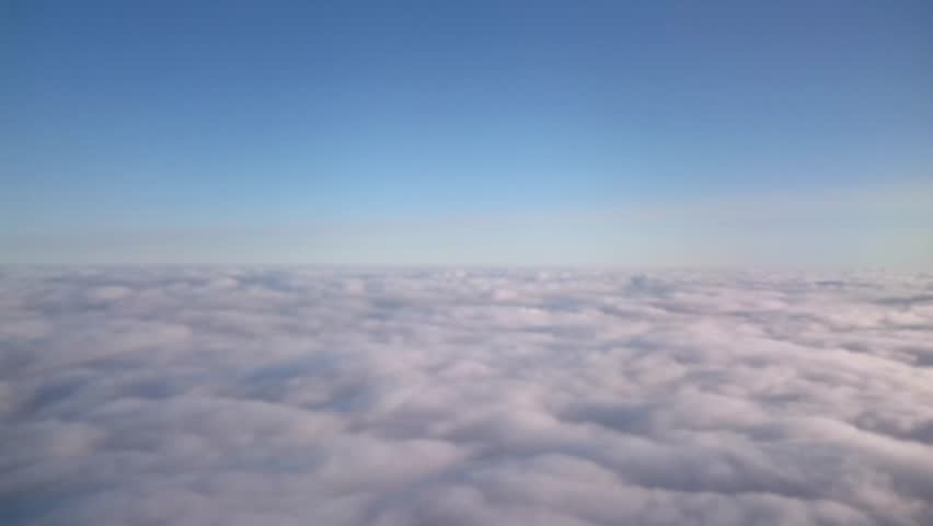 Flying in the air with clouds passing by. Medium shot from an aerial perspective of moving clouds Cloudscape of skies  | Shutterstock HD Video #9924431