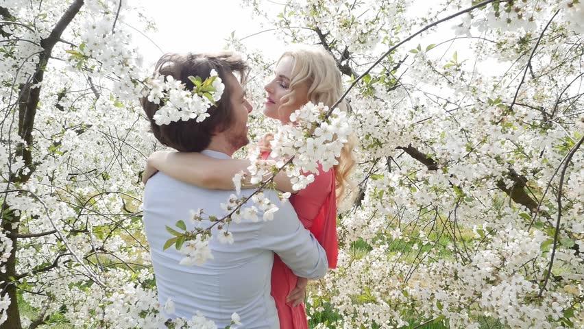 Happy couple having fun in garden - slow motion | Shutterstock HD Video #9934958