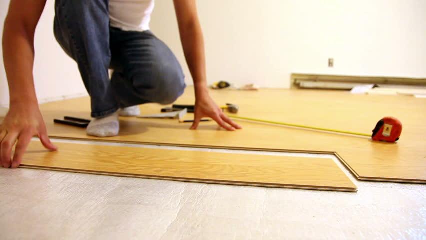 Man Installing Laminate Flooring Stock, Laminate Flooring Free Installation