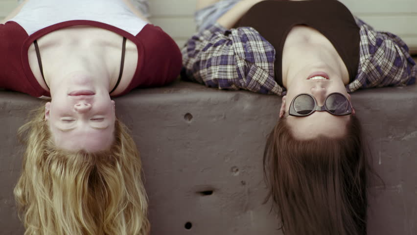 Best Friends Hang Out On A Loading Dock, They Lay Down, And Chat (4K)