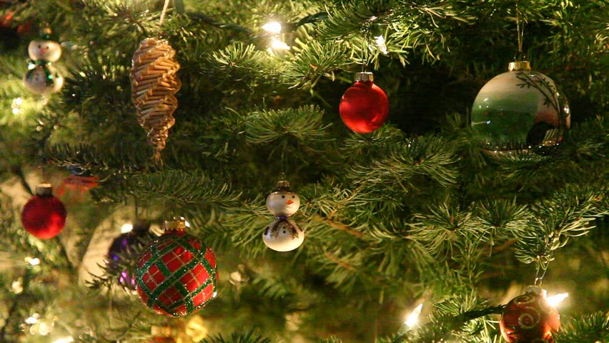 Christmas ornaments are decorations (usually made of glass, metal, wood or ceramics) that are used to festoon a Christmas tree. | Shutterstock HD Video #996331