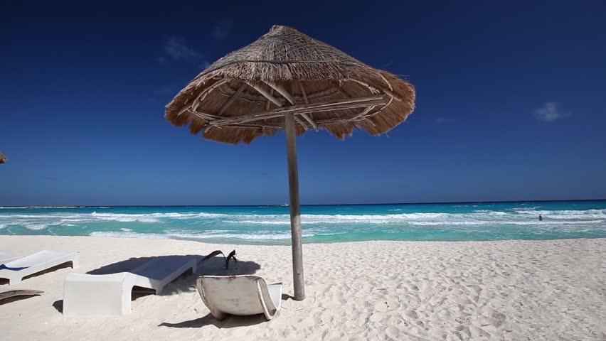 Caribbean Beach With Gr Umbrellas