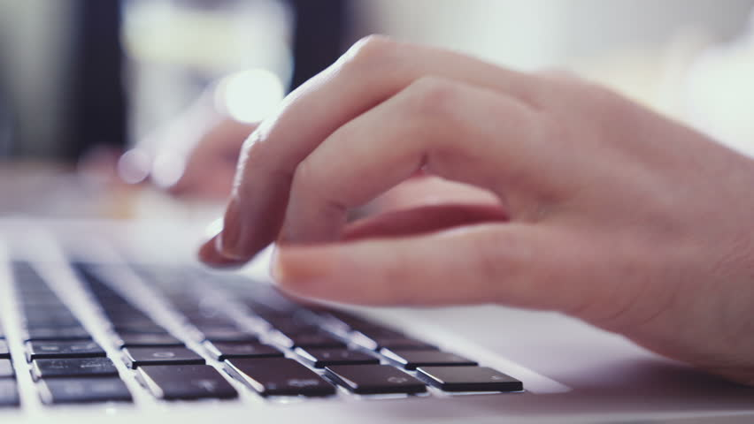 Closeup of business woman hand typing on laptop keyboard. Closeup of a female hands busy typing on a laptop. Woman's hands pressing keys on a laptop keyboard trying to access data.