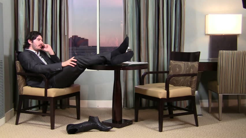 Businessman relaxes while talking on cell phone - HD | Shutterstock HD Video #998722