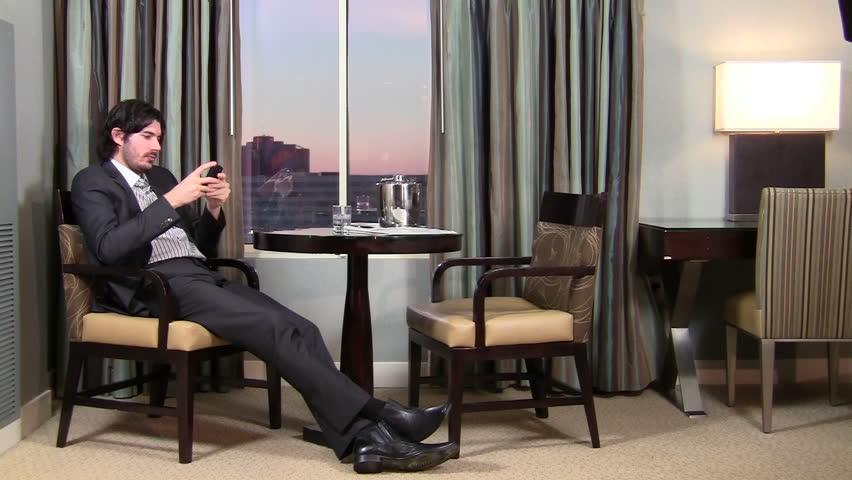Successful businessman texts in luxury hotel room - HD | Shutterstock HD Video #998734